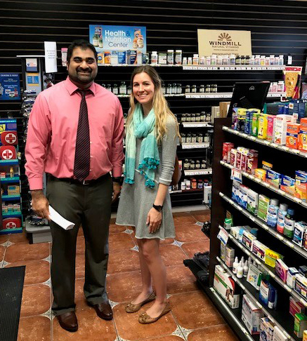 Amy Strain, Field Representative for State Senator Jane Nelson, meets with  Express Care Pharmacy owner Shinu Punnoose.